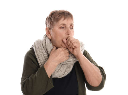 Elderly woman suffering from cough on white background