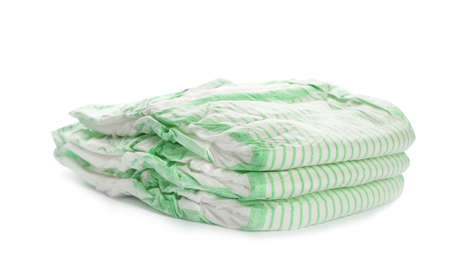 Stack of disposable diapers on white background. Baby accessories