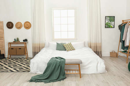 Stylish room interior with comfortable double bed
