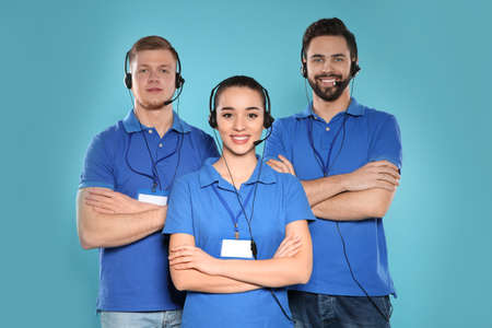 Group of technical support operators on color background