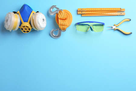 Flat lay composition with construction tools on color background, space for text