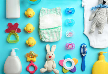 Flat lay composition with baby accessories on color background