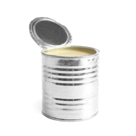 Tin can with condensed milk on white background. Dairy product