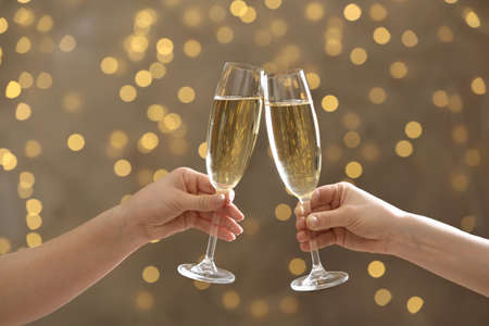 People clinking glasses of champagne on blurred background, closeup Banco de Imagens