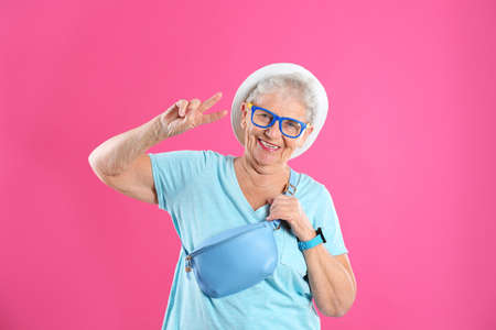 Portrait of cool grandmother on color background Stock Photo