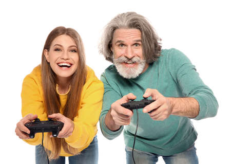 Mature man and young woman playing video games with controllers isolated on white
