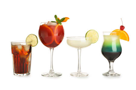 Glasses of traditional alcoholic cocktails on white background
