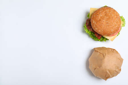 Fresh burgers on white background, top view