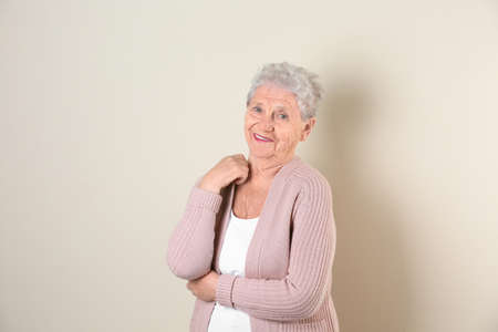 Portrait of grandmother in stylish clothes on light background