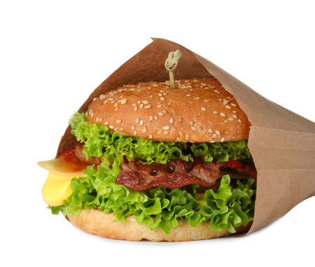 Fresh burger in craft paper on white background