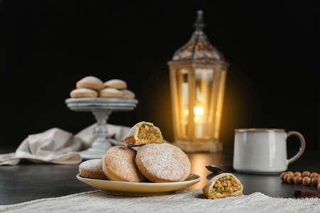 Traditional cookies for Islamic holidays on table. Eid Mubarak