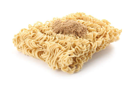 Block of quick cooking noodles with spices isolated on white