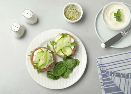 Flat lay composition with traditional English cucumber sandwiches on grey background Foto de archivo