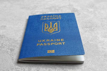 Ukrainian travel passport on grey background, closeup. International relationships