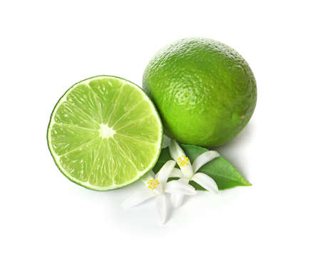 Ripe limes and flowers on white background. Citrus fruit