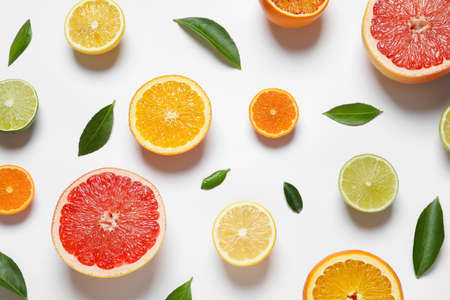 Flat lay composition with different citrus fruits on white background
