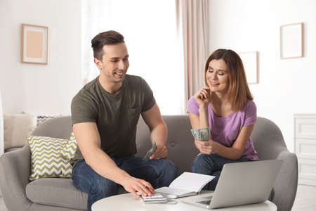 Couple managing budget to save money in living room