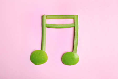 Musical note made of fruits and vegetables on color background, top view Stock Photo