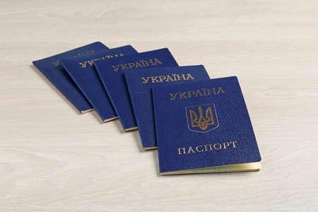 Many Ukrainian internal passports on wooden background Stock Photo