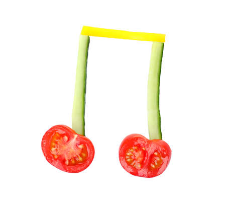 Musical note made of vegetables on white background, top view
