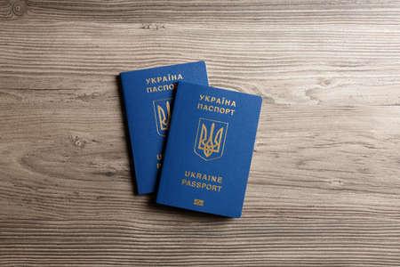 Ukrainian travel passports on wooden background, top view. International relationships