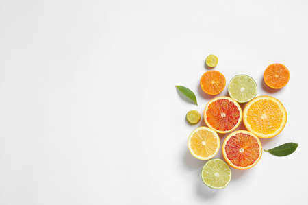 Composition with different citrus fruits on white background, top view Stock Photo