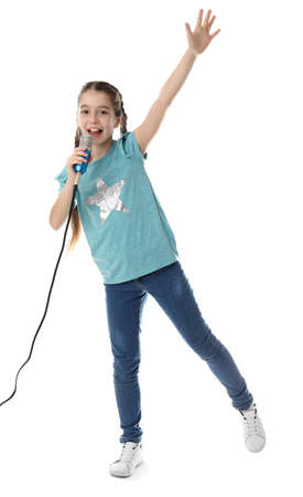 Cute girl singing in microphone on white background Фото со стока - 121361688