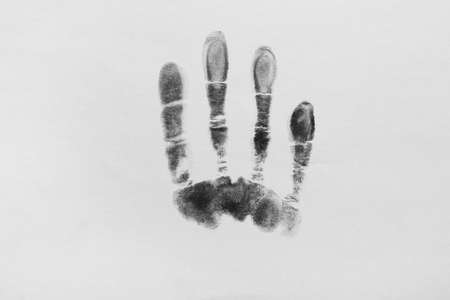 Print of hand and fingers on white background, top view. Criminal investigation