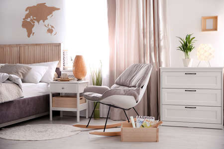 Modern eco style interior with wooden crates and comfortable bed Imagens