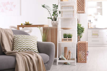 Modern eco style living room interior with wooden crates and sofa Archivio Fotografico