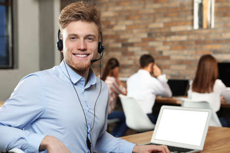 Technical support operator with headset in modern office Stok Fotoğraf
