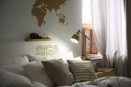 Modern eco style interior with wooden crates and comfortable bed Reklamní fotografie