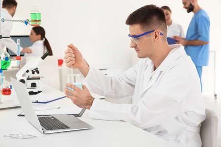 Medical student working in modern scientific laboratory Фото со стока