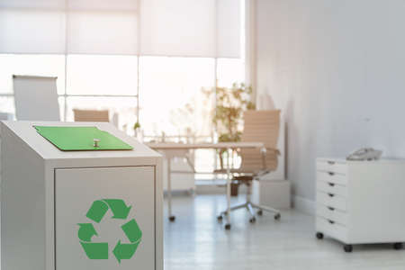 Trash bin in modern office, space for text. Waste recycling
