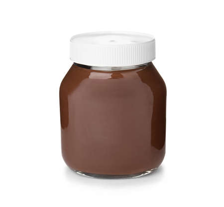 Glass jar with tasty chocolate cream isolated on white background