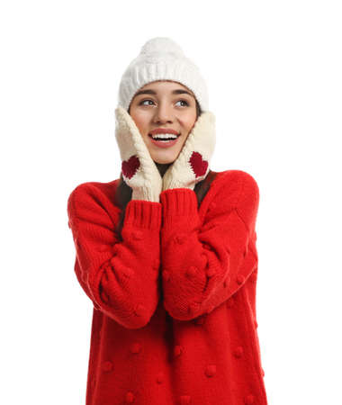 Young woman wearing warm clothes on white background. Winter season