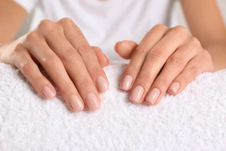 Closeup view of beautiful female hands on towel. Spa treatment