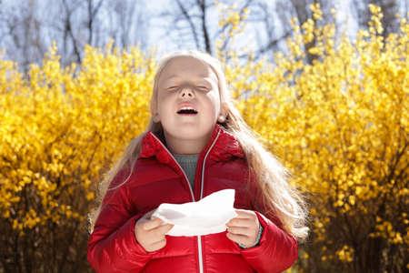 Little girl suffering from seasonal allergy outdoors
