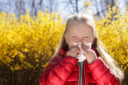 Little girl suffering from seasonal allergy outdoors, space for text