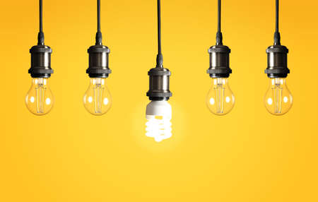 Many hanging lamp bulbs on color background. Symbol of idea and solution Reklamní fotografie