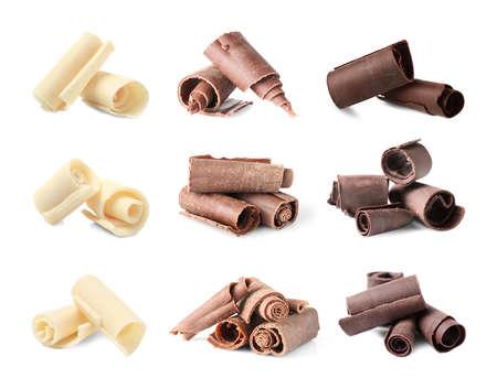 Conjunto de diferentes rizos de chocolate delicioso sobre fondo blanco. Foto de archivo