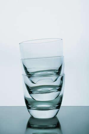 Stack of empty whiskey glasses on white background