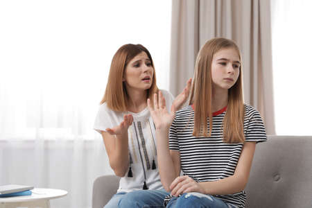 Mother scolding her teenager daughter at home