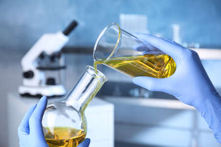 Scientist doing analysis in lab, closeup. Solution chemistry
