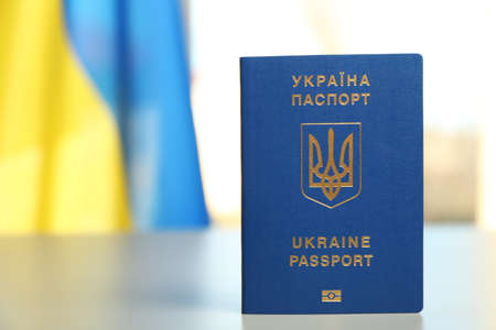 Ukrainian travel passport on table against blurred background, space for text. International relationships