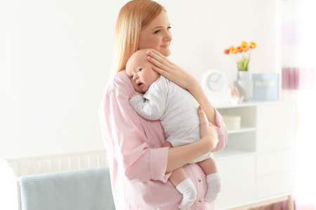 Happy mother and her baby at home Stock Photo - 122121730
