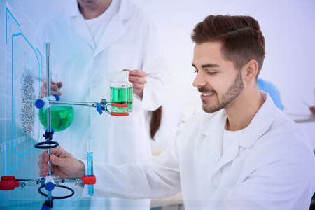 Medical student working in modern scientific laboratory, color tone Stockfoto