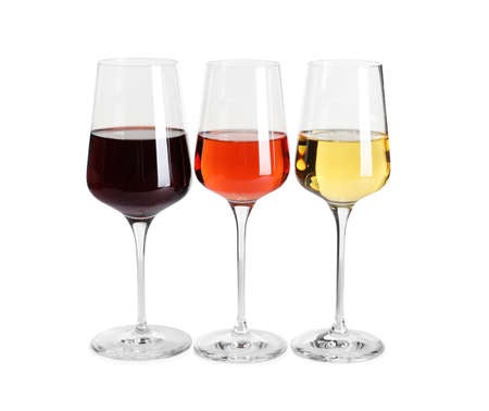 Glasses of different delicious expensive wines on white background 写真素材