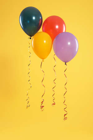 Bright balloons on color background. Celebration time