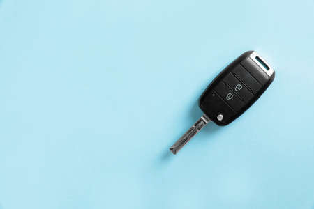 Car key on color background, top view with space for text